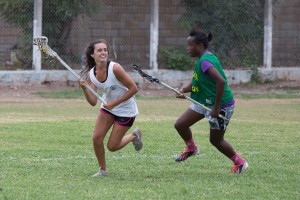 Jamaican HS girls in a scrimmage against an NCAA women's lacrosse player at camp last summer.